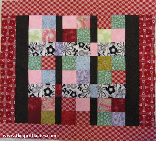 4 patch quilt block pattern for a table topper