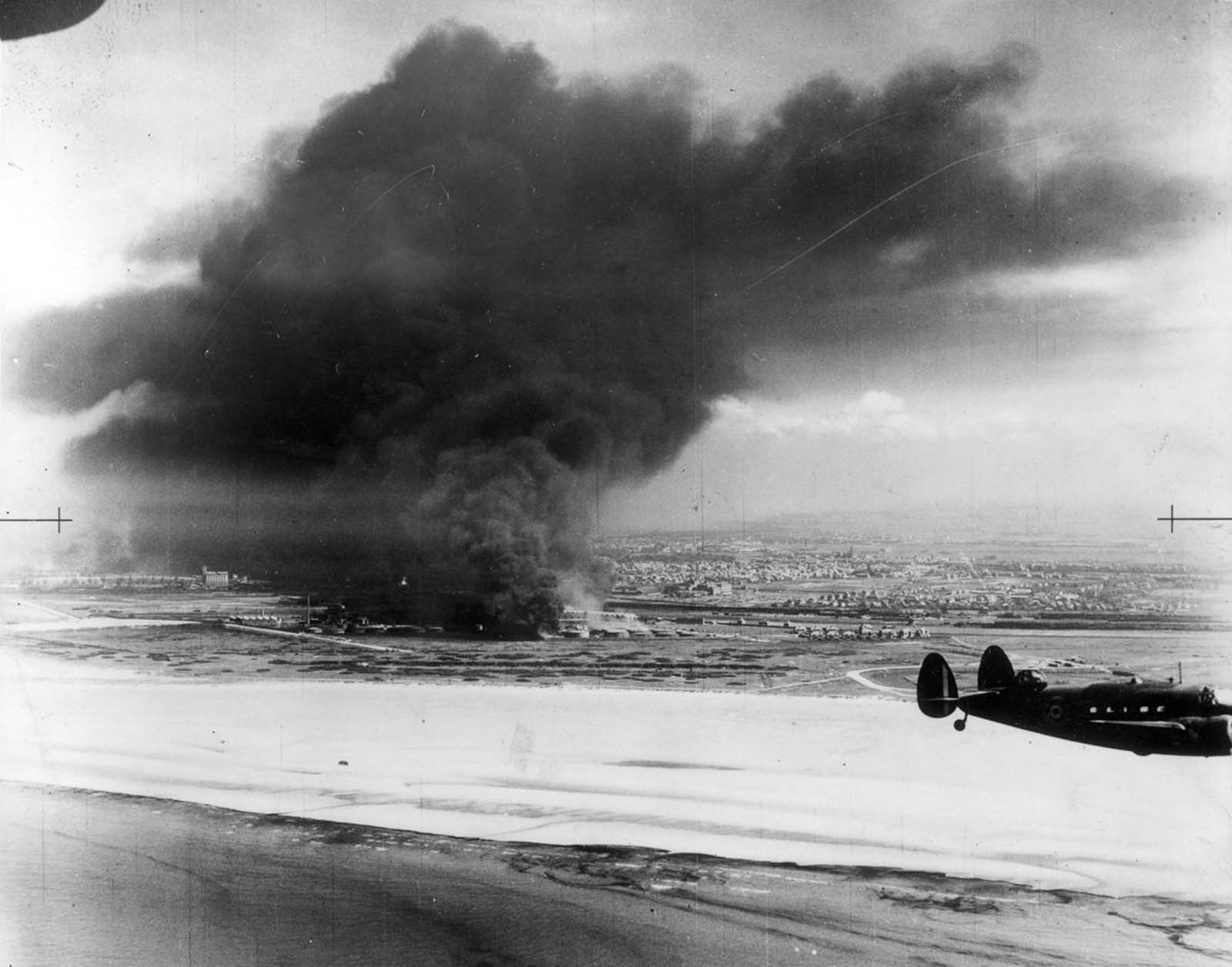 Oil tanks burn on Dunkirk beach.