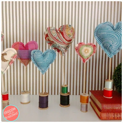 http://dazzlewhilefrazzled.com/diy-fabric-heart-decorations/
