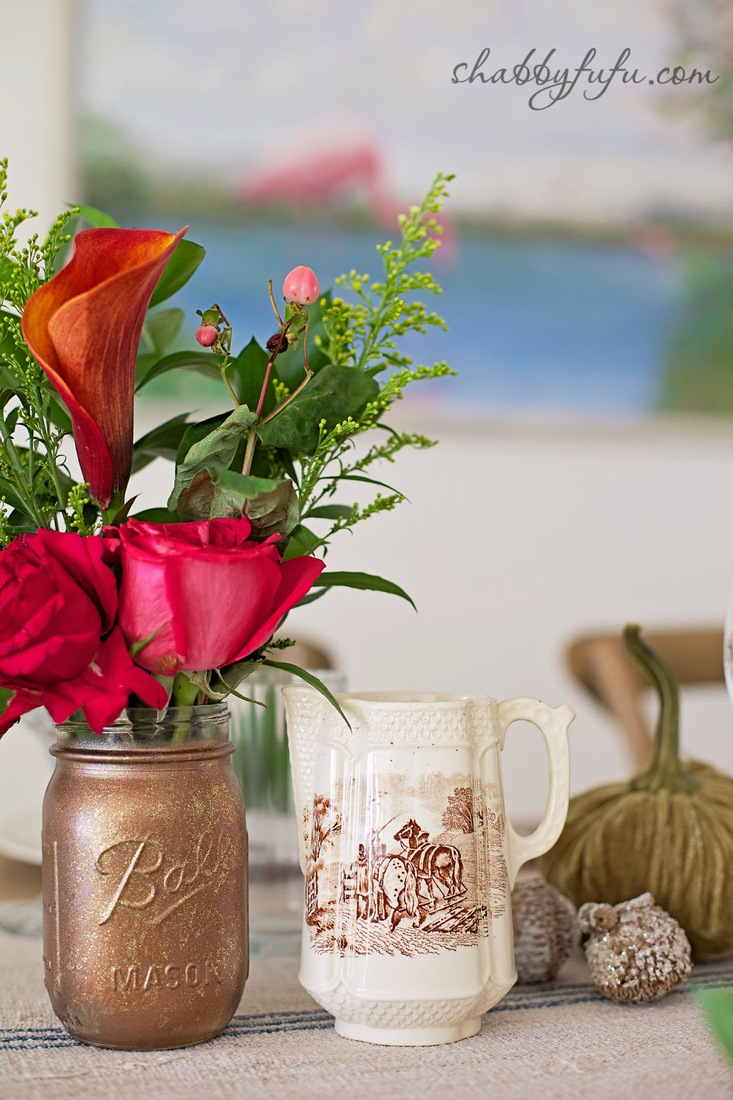 Thanksgiving Beach House decor - gold painted mason jars with fall flower arrangements