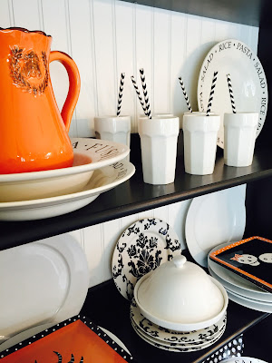 Fall decorated hutch, Ikea shelving, black and white dishes, Orange Halloween dishes