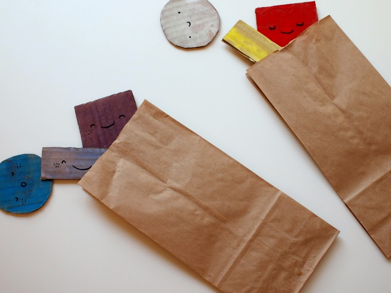 place your shapes into brown paper bags