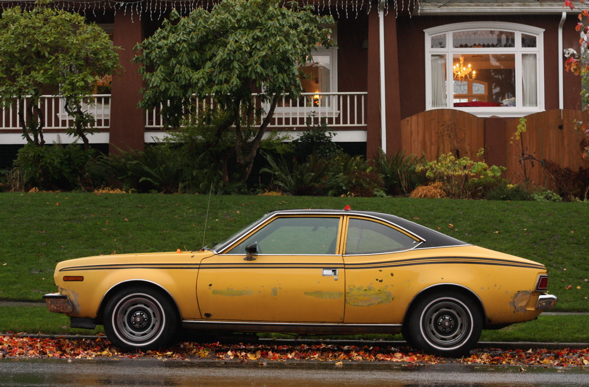 OLD PARKED CARS.: 1973 AMC Hornet X Hatchback