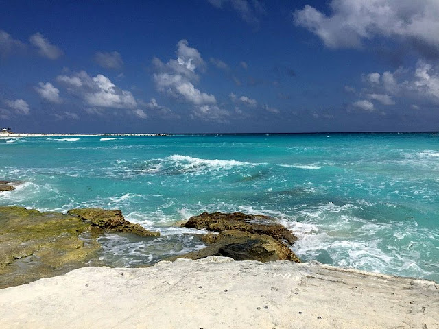 a landscape of wave, rock on the Cancun beaches