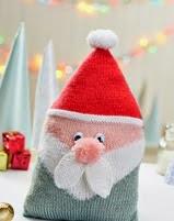 http://www.letsknit.co.uk/free-knitting-patterns/santa-cushion