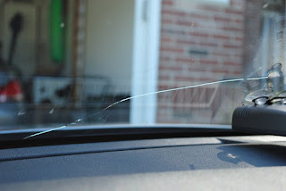 close view of a cracked windshield