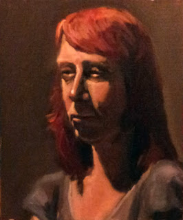Oil painting of a woman with shoulder-length dyed red hair wearing a blue top.