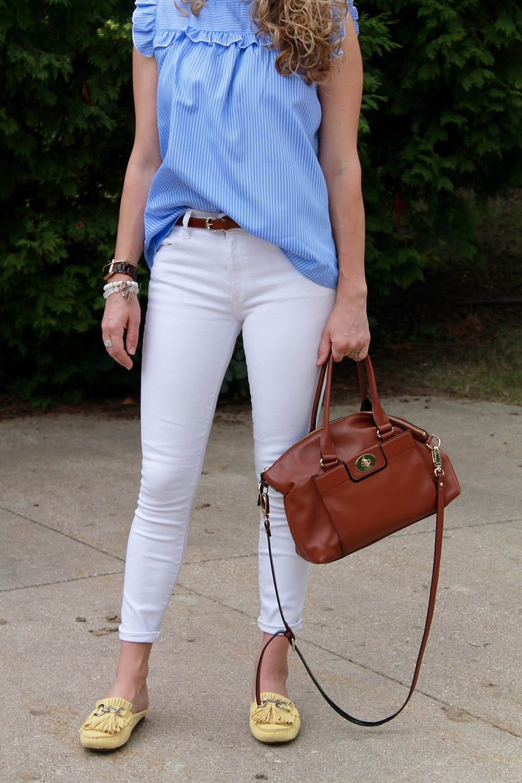 blue pinstriped sleeveless blouse, white jeans, yellow mules, cognac Kate Spade bag