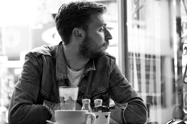 Image of a man looking out of a cafe window. Copyright Ashley Laurence - Time for Heroes Photography