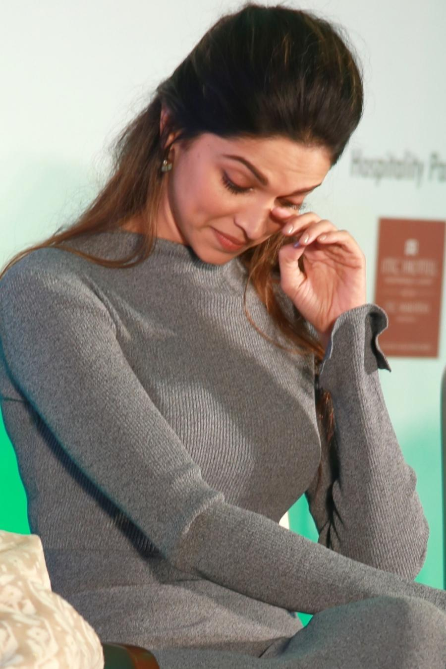 Actress Deepika Padukone Long Hair Stills In Black Coat