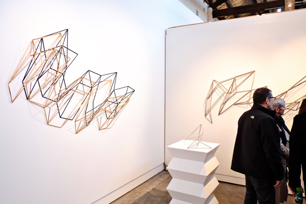 On the wall, a view of Dion Horstmans, Heavy Metal at Brenda May gallery. Photographed by Kent Johnson for Street Fashion Sydney.