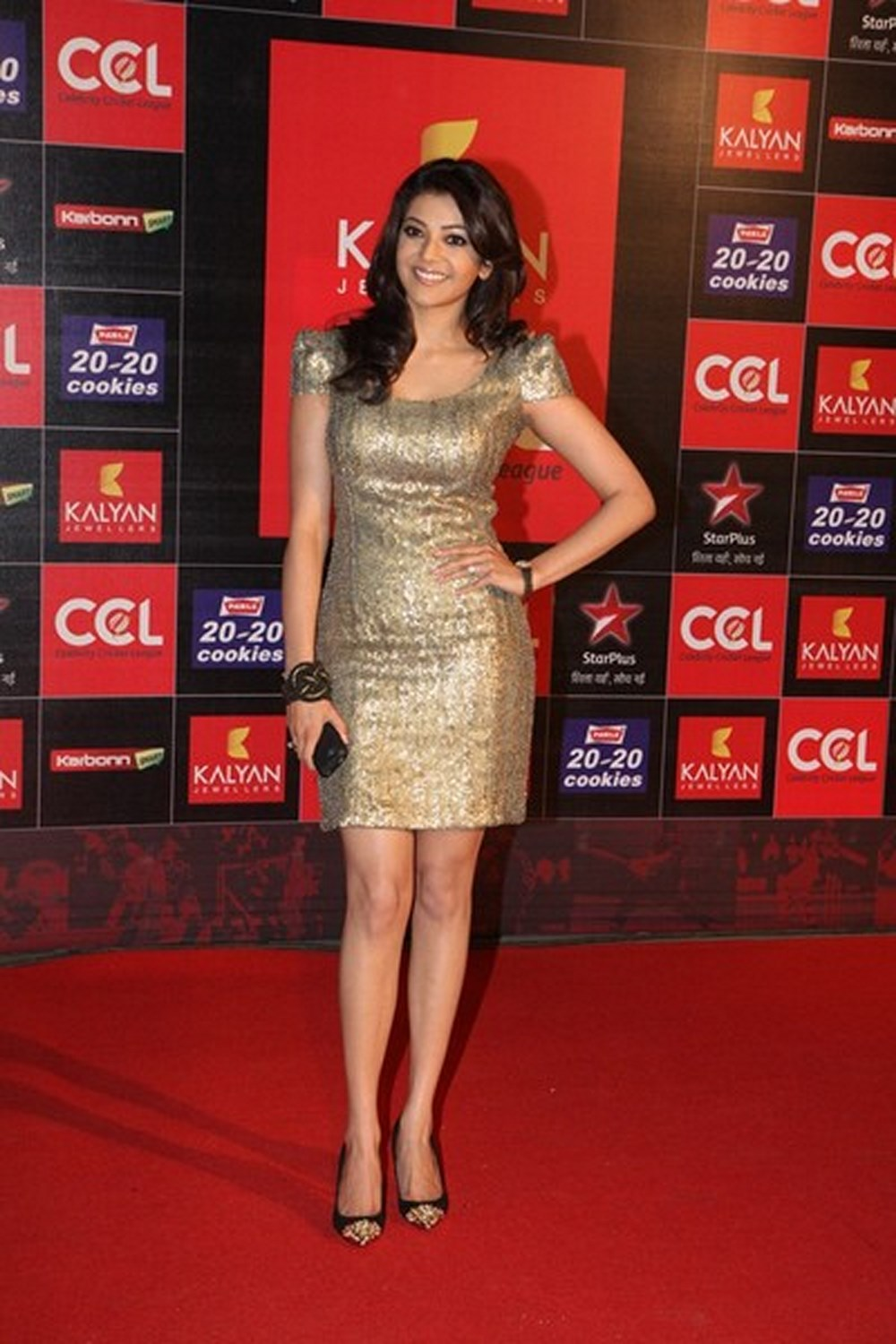 Kajal Agarwal Stills In Golden Mini Skirt At CCL Event