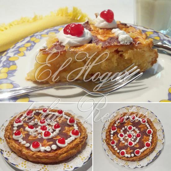 Tata de almendra sobre base de hojaldre, decorada con merengue y cerezas en almíbar
