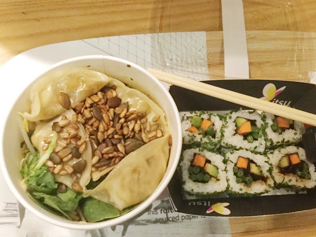 Vegetable filled dumping in a noodle and vegetable broth topped with spinach,pumpkin and sunflower seeds. Alongside white rice sushi club rolls filled with carrot and avocado.