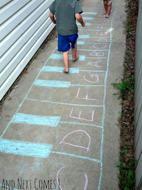 Chalk keyboard drawing with the musical alphabet written on it