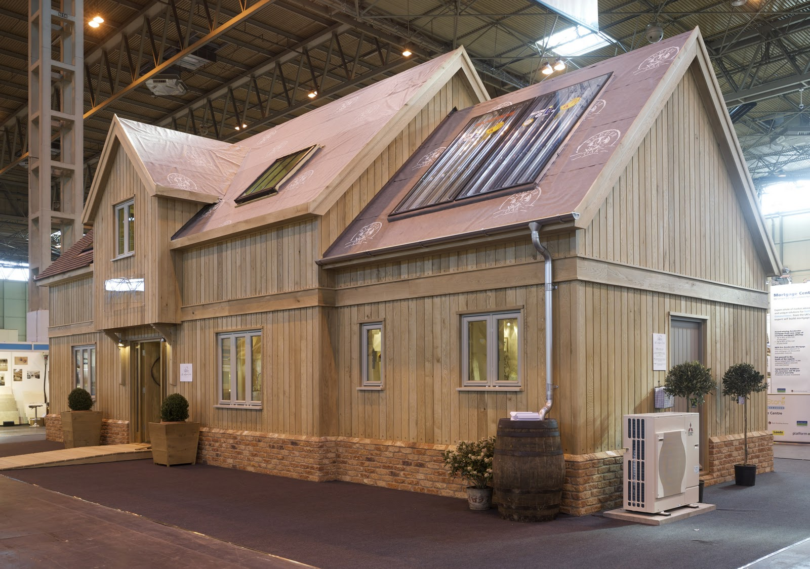 Front   The Solar Panels Provide Domestic Hot Water And The Air Source Heat  Pump Fires The Underfloor Heating