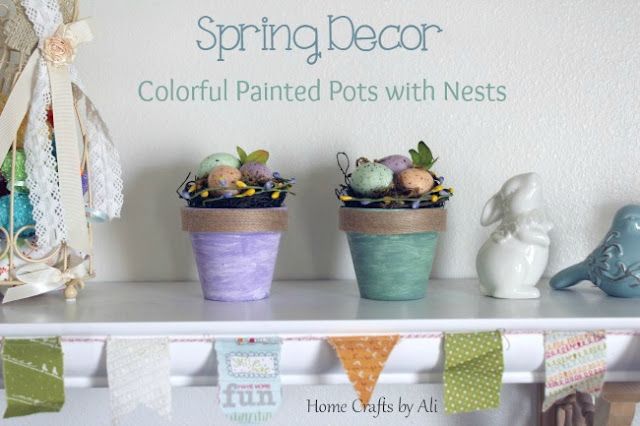 colorful painted terra cotta pots with nests in spring decorations