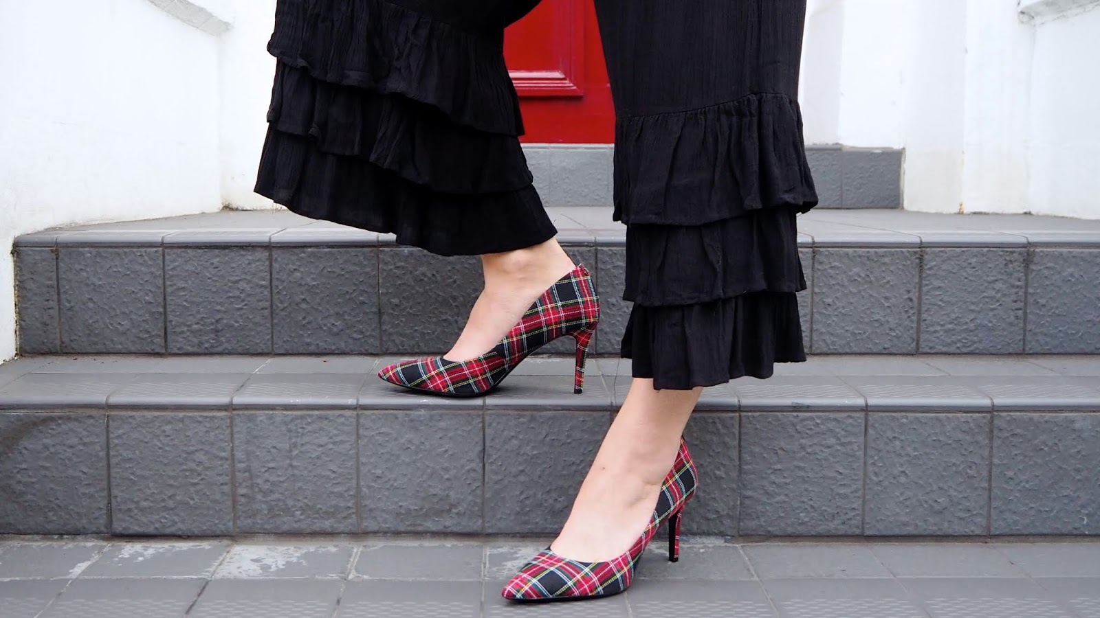 red and black plaid high heels and black ruffled cropped trousers