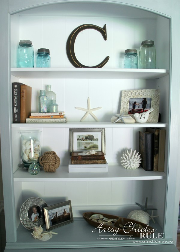 coastal bookcase decor with mason jars