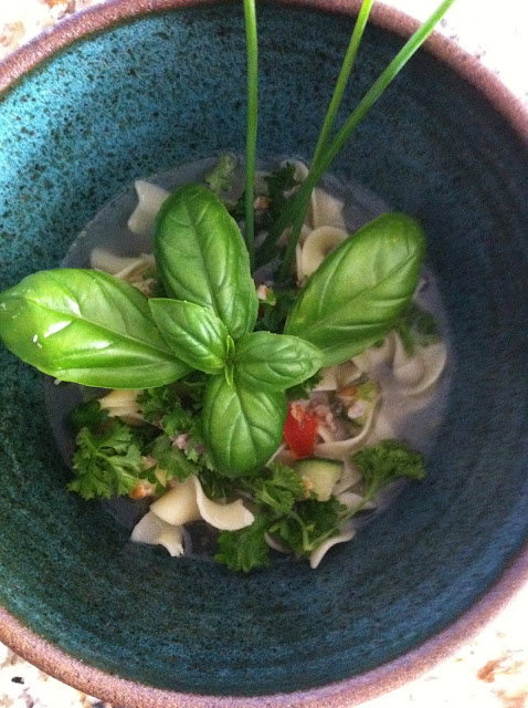 chicken bone broth with tabbouleh and garden fresh herbs soup