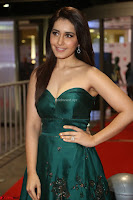 Raashi Khanna in Dark Green Sleeveless Strapless Deep neck Gown at 64th Jio Filmfare Awards South ~  Exclusive 129.JPG