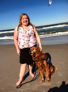 Michelle and her guide Golden Retriever Tango on a beautiful beach