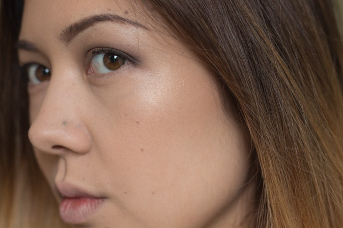 becca x jaclyn hill shimmering skin perfector highlighter champagne pop worn on face