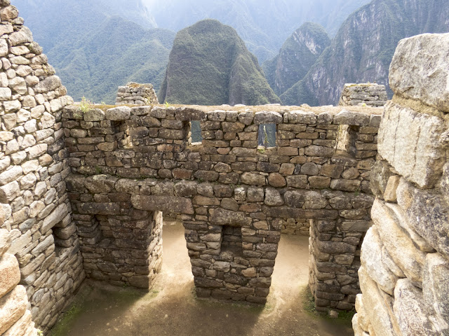 Machu Picchu Pics: Two trapezoidal doors at Machu Picchu with views of the Andes beyond.