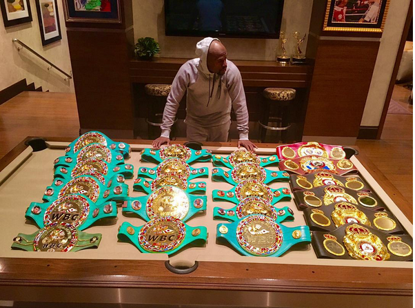 Floyd mayweather and his 22 world title belts