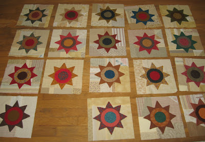 appliqued stars with circles on scrappy backgrounds