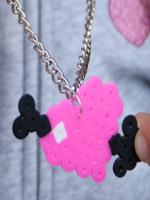 http://www.manualidadesinfantiles.org/collar-corazon-flechado-de-hamma-beads