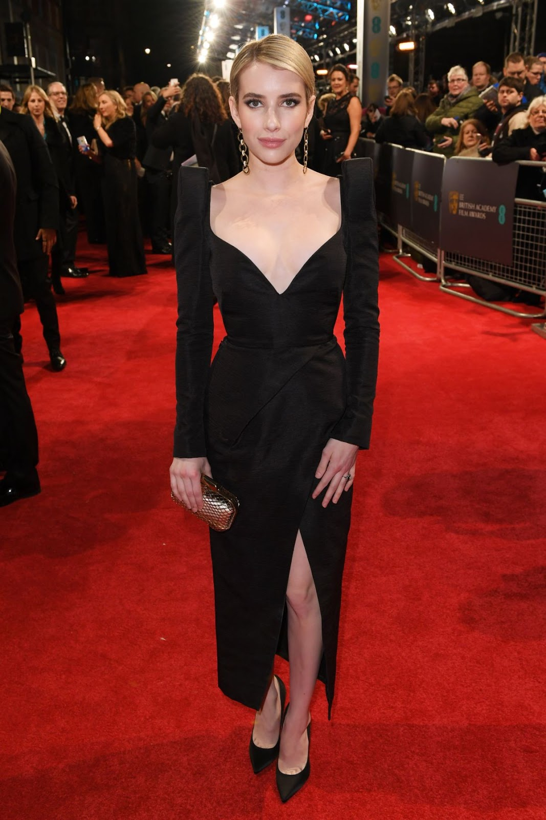 Emma Roberts Wears Low Cut Black Dress To The 2018 Baftas