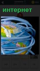 земной шар опутан проводами, показывая всемирный интернет