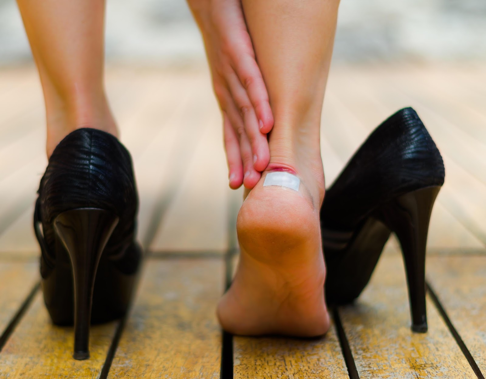 There is a risk of physical injury from slipping or falling, as well as possible damage to the feet, legs and back from prolonged wearing of high heels while at work