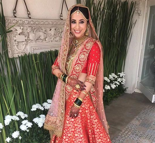 Urmila Matondkar Looks Majestic at her Wedding, Urmila Matondkar, the Rangeela girl went all red on her wedding day. She tied knot with Mohsin Akhtar Mir in a private ceremony yesterday in Mumbai. She looked as gorgeous as the hues of heaven. She looked picture perfect in the Manish Malhotra ensemble. The actress was the face of the designer for quite some time. He, who is also her closest friend, dressed her up in a beautiful tomato red and golden lehenga that is heavily embellished. He even had her chunar or the dupatta designed in detail for her grand event. She kept the jewellery heavy and traditional along with a maatha patti and didn't forget to showcase her Marathi traditions with the green bangles. She looked angelic at her reception in a gold shimmering white suit. Her hair as always looked wavy adding grace to her gorgeous looks. All our love and best wishes to the sizzling actress on her new beginning. (Copied from Indian Fashion Blog)