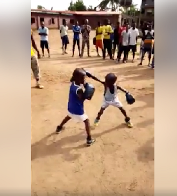 1 - Viral video of two children in a boxing match while adults cheer on