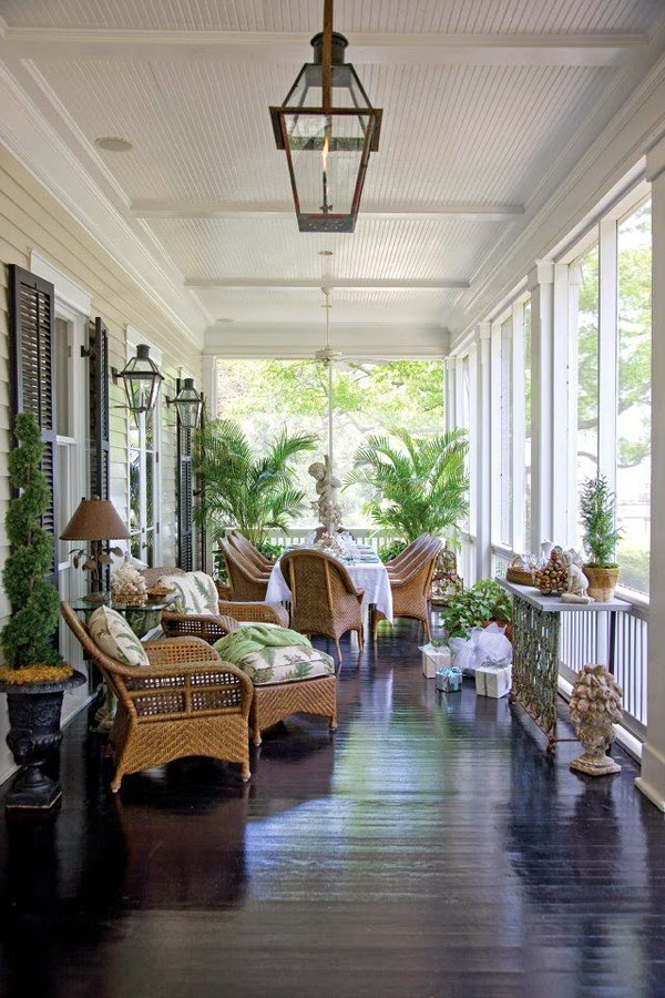 Gorgeous Porch with Palms, Lanterns, and Wicker Furniture