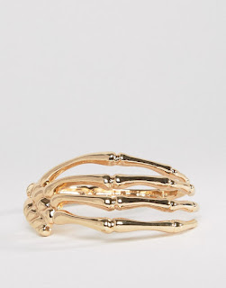 http://www.asos.com/asos/asos-skeleton-hand-bracelet-in-gold/prod/pgeproduct.aspx?iid=6521273&clr=Gold&SearchQuery=halloween&pgesize=204&pge=0&totalstyles=265&gridsize=3&gridrow=9&gridcolumn=2