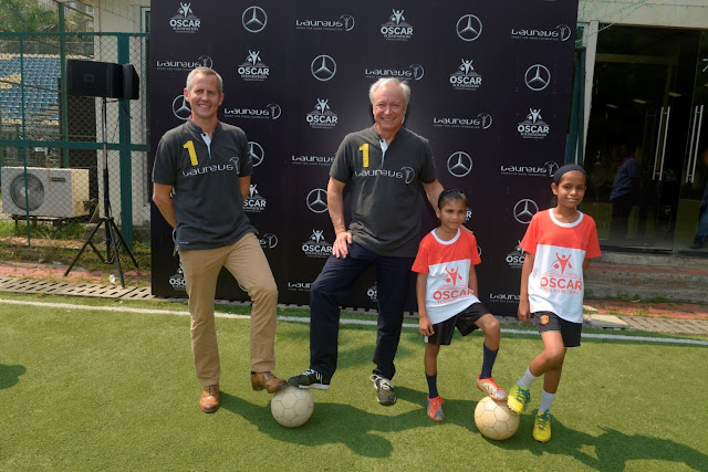 Mr. Roland Folger, MD & CEO, Mercedes-Benz India and Andy Griffiths, Global Director, Laureus Sport for Good all set to play football with OSCAR Foundation kids-min