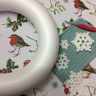 Polystyrene ring, snowflakes and crochet fabric