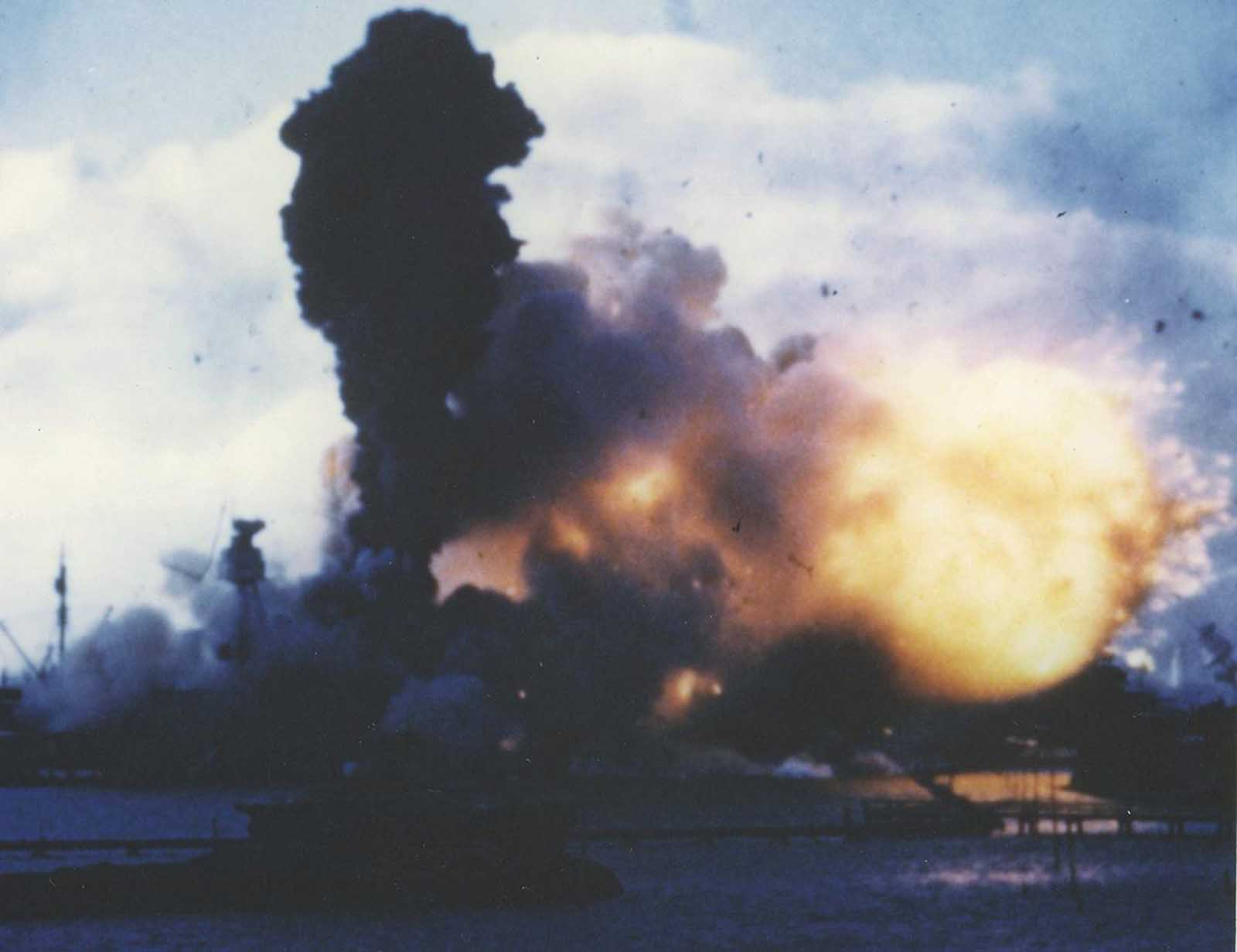 The forward magazines of USS Arizona explode after she was hit by a Japanese bomb on December 7, 1941. Frame clipped from a color motion picture taken from on board USS Solace.
