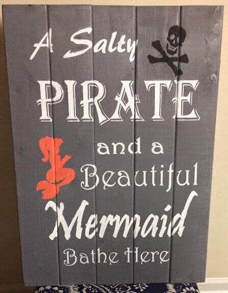 A salty pirate and a beautiful mermaid bathe here