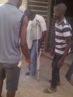 Amazing!!  A one legged man lift a bag of cement
