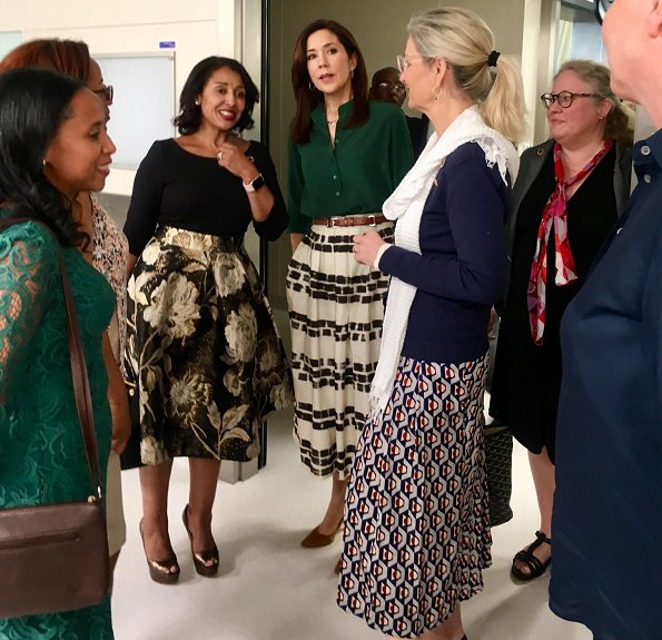 Tory Burch black and white pleated midi skirt and Etro skirt, a green silk blouse, Gianvito Rossi suede pumps, Ralph Lauren bag