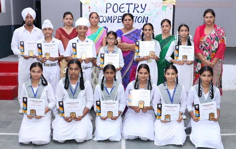 Prize winners pose for a group photograph after Poem Recitation Competition at RS Model School