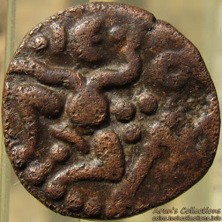 Seated figure, pellets(worn out), parasu, tamil 'cha'(ச) above.