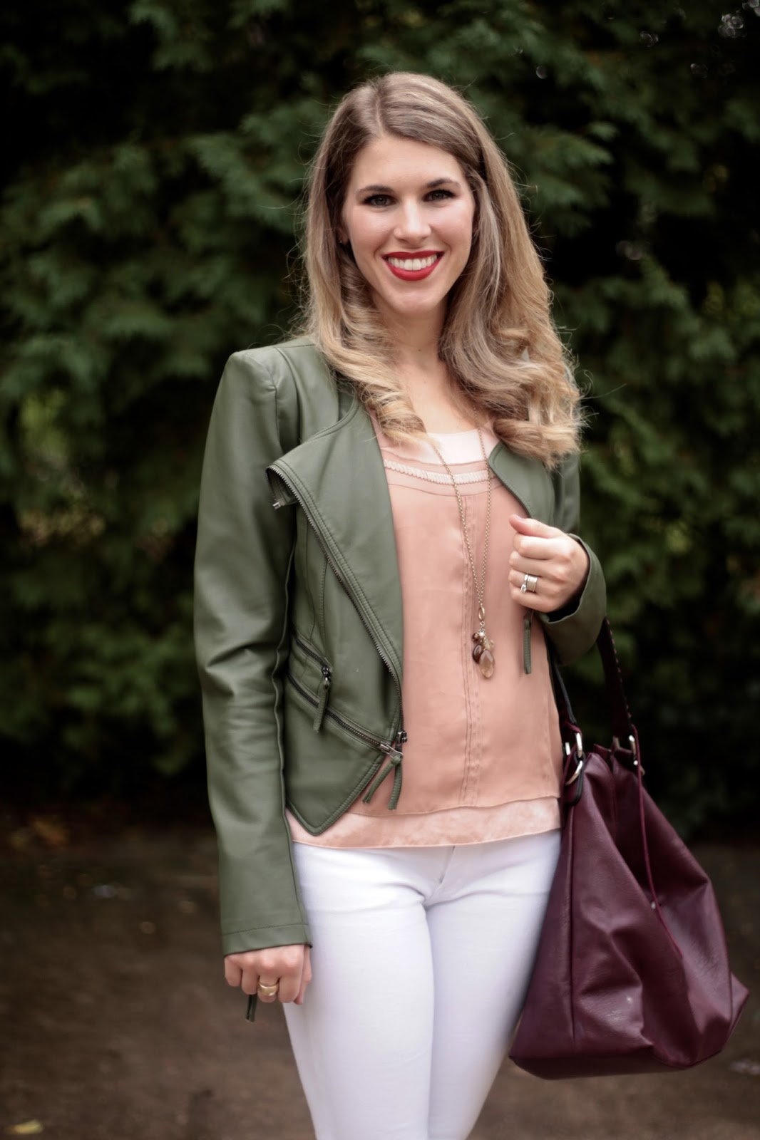 blush tank, white jeans, olive moto jacket, burgundy bag, leopard heels