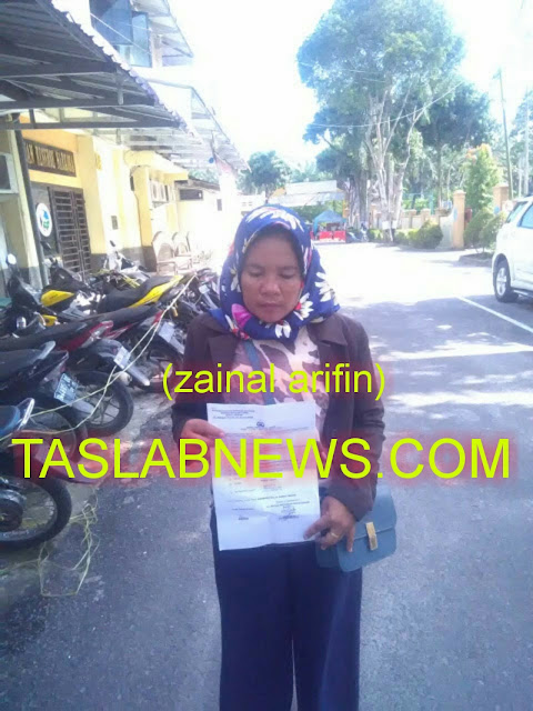 Nursiam istri yang dianiaya suaminya saat membuat laporan ke polisi.