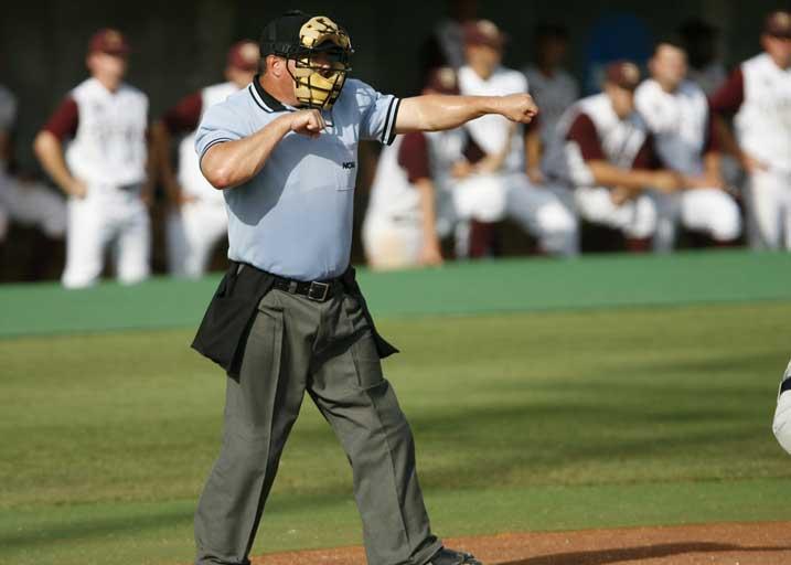 Umpire calling a strike