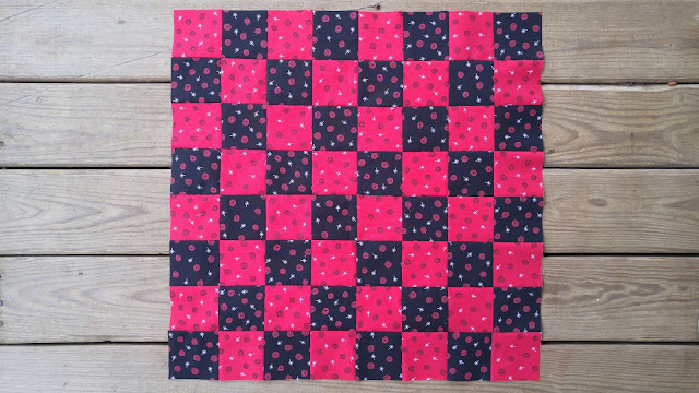Red and black checkerboard checkers quilt